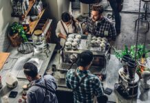 man buying coffee on counter